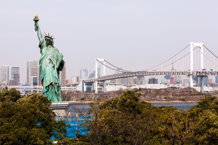 Statue of Liberty and Tokyo Skyscrapers view from Odaiba, Japan Editorial