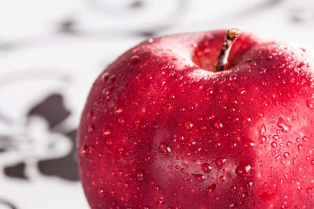 Part of red apple with drop on surface