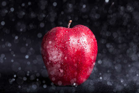 Close up red apple with drop on surface Stock Photo
