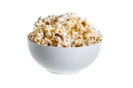 Popcorn in ceramic bowl on isolated white photo