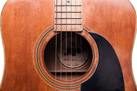 Old classic acoustic guitar isolated on white Stock Photo