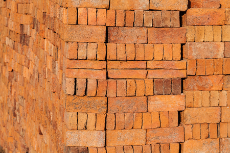 Stacked of bricks at the construction site