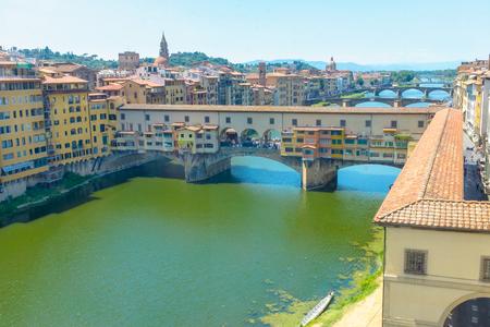 Ponte Vecchio on the river Arno , a Renaissance bridge, the oldest elliptic arch bridge in Europe , Tuscany, Italy