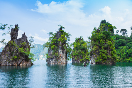 kao sok: Natural attractions from a long-tailed boat in Ratchaprapha Dam at Khao Sok National Park, Suratthani Province, Thailand.