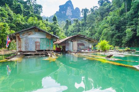 kao sok: The Hut reflection on water at Ratchaprapha Dam at Khao Sok National Park, Suratthani Province, Thailand.