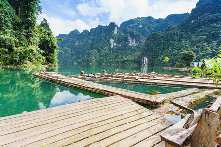 kao sok: The Floating bamboo raft and Long tail boat on water at Ratchaprapha Dam at Khao Sok National Park, Suratthani Province, Thailand.