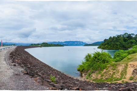 Ratchaprapha Dam at Khao Sok National Park with beautiful mountains on the horizon, Surat Thani Province, Thailand