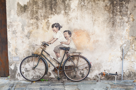 PENANG, MALAYSIA - MAY 8 2016: Graffiti on the wall in Georgetown, Penang, Maylaysia, Tourist destination in Malaysia