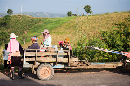 PISANULOOK, THAILAND, NOVEMBER 06 2016,  Farmers on E-tan,Thai  local farmer vehicle parking in front of wind turbine farm, Pitsanulook, Northern of Thailand