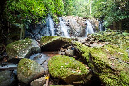 Waterfall hidden in the rainforest jungle, Thailand
