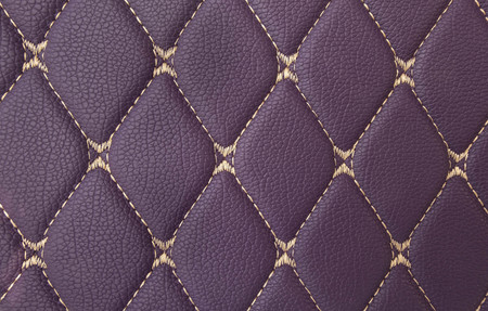 classic purple leather Mat with straight beige stitching soft leather for machine with textured pattern concept background fabric business