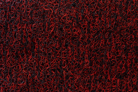 rubber Mat of interlacing threads black and red machine foot Shoe lint-free textured pattern textured collection concept background business Imagens