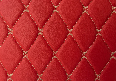 red leather Mat with straight beige stitching soft leather for machine with textured pattern concept background fabric business Reklamní fotografie