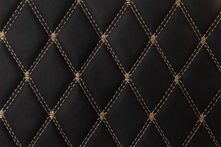 classic black leather Mat with straight beige stitching soft leather for machine with textured pattern concept background fabric business