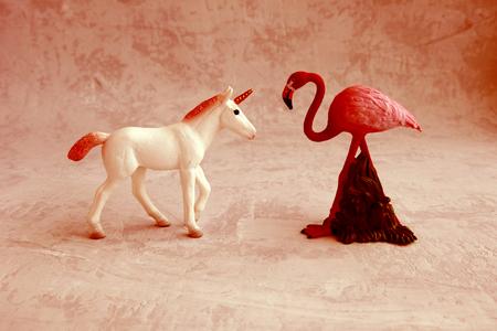 a unicorn and a flamingo, the concept of love. Banco de Imagens