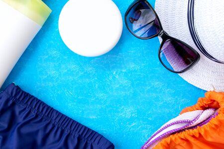 Stylish flat lay created from summer props hat, glasses and lips. Summer concept, good party set. Top view. Copy space.