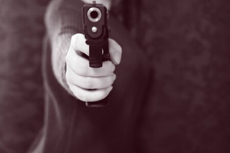 Gun Girl Points a 9 mm Caliber Snub Nose Revolver Weapon Right at The Viewer. concept self-protection