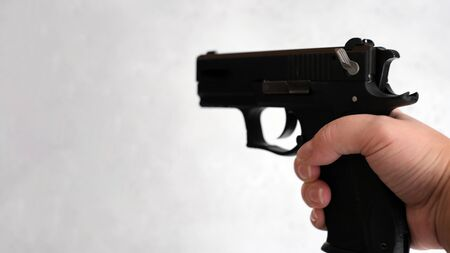 a pistol 9mm, in the hands of women, concept as correctly keep a pistol on training.
