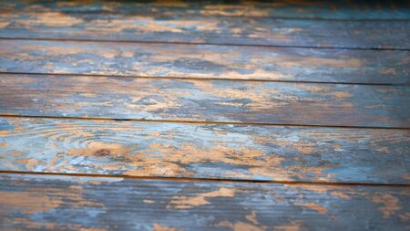 backgrounds and texture concept - old wooden fence painted in blue background Stock Photo