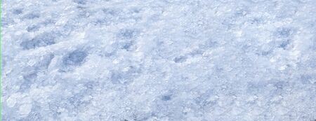 Broken crushed ice fresh cold white winter snow background