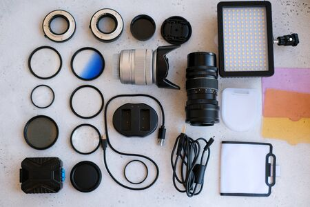 Flat lay composition with equipment for professional photographer on grey background 版權商用圖片