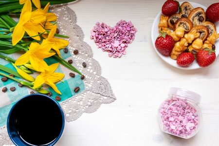 strawberries, cookies hearts with coffee, yellow flowers daffodils for Valentine mother woman Easter day with love together with a place for text