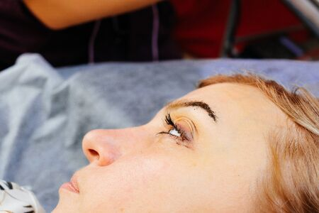 the eyebrow spraying process in the technique of powdery, nano permanent makeup. Women's beauty and eyebrow care, an alternative to pixel, velvet, hardware spraying.