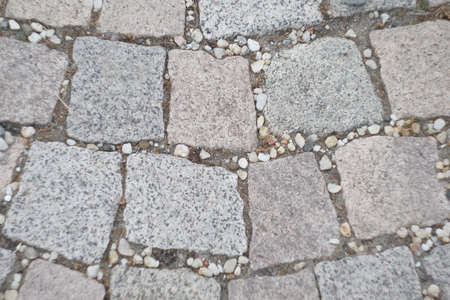 background street tile. Stone pavement texture. Granite cobblestoned pavement background. Abstract background of old cobblestone pavement close-up. Seamless texture. Perfect tiled on all sides.