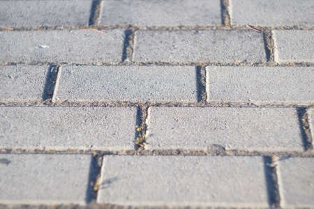 background street tile at an angle. Modern city square floor texture background,high angle view