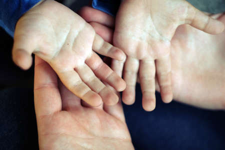 Childs hands holding offering giving something or asking begging for something.