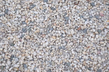 background of small colorful pebble. Sea pebbles. Small stones gravel texture background.Pile of pebbles, thailand.Color stone in background.
