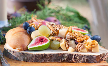 wood plate whith figs nuts and chease