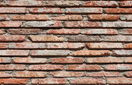 Old wall of red bricks tiled background, regular block texture. Wallpaper of ordinary building. Tiles. Background Stock Photo