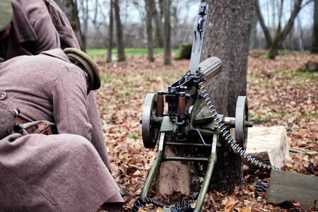retro machine gun and soldiers in the forest Stock Photo