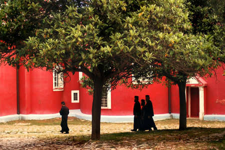 Orthodox monks go to the Vespers in the monastery on Athos