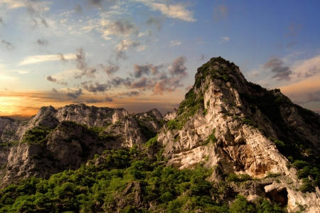 scenical: Sandstone rock cliffs in sunset in Italy