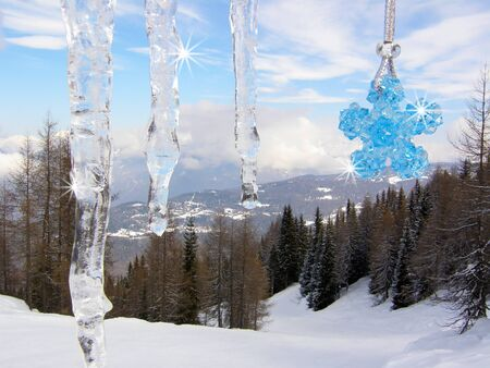Icicles with blue crystal beads star in the mountains - sharp background photo