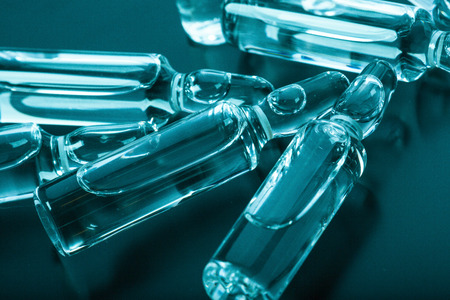 tinting: Photo medical ampoules on a dark background in blue-green tinting Stock Photo