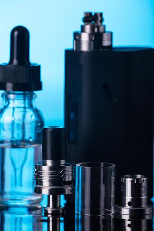 background e cigarette: photos of electronic cigarette dark blue glossy background
