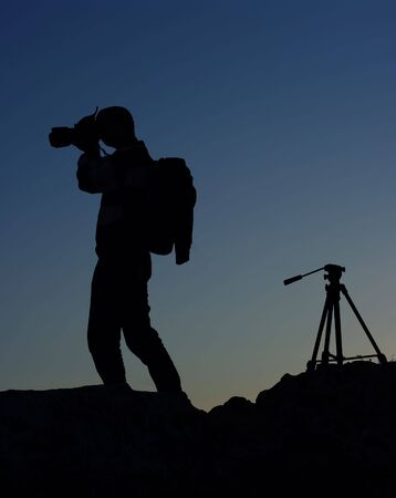 Photographer silhouette at sunset photo