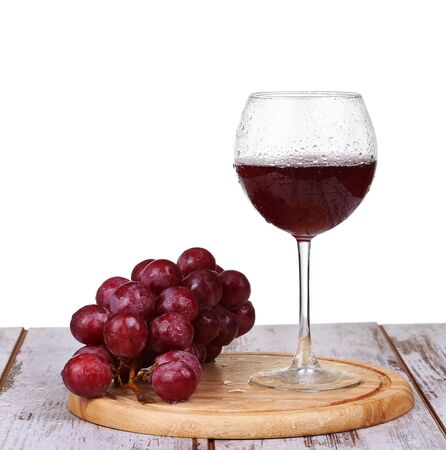 sommeliers: wine pouring into glass with grape and bottles isolated