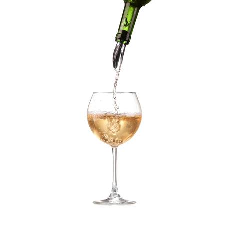 Wine in glass pouring from bottle and make splash, dispenser on the bottle