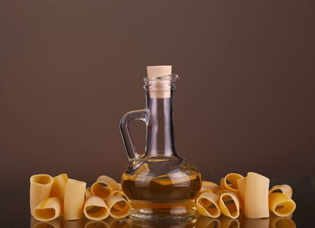 unboiled: raw pasta olive oil. italian cuisine in rustic kitchen Stock Photo