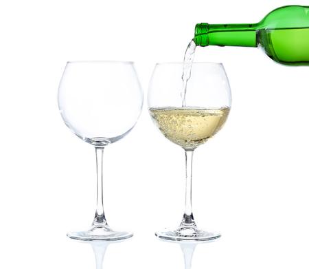 White wine poured into glass