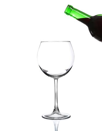 Bottle red wine with glass (with clipping path), isolated on white background.