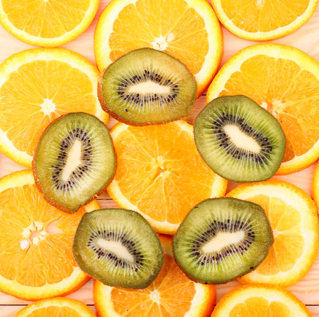 Oranges, kiwi on a wooden surface (seen from above) Stock Photo