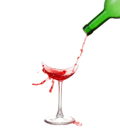 Broken glass with wine and drops ,isolated on white background