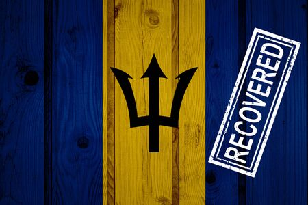 flag of Barbados that survived or recovered from the infections of corona virus epidemic or coronavirus. Grunge flag with stamp Recovered Stok Fotoğraf