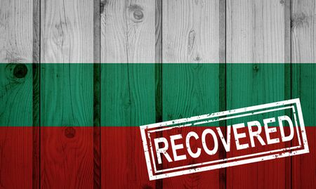 flag of Bulgaria that survived or recovered from the infections of corona virus epidemic or coronavirus. Grunge flag with stamp Recovered