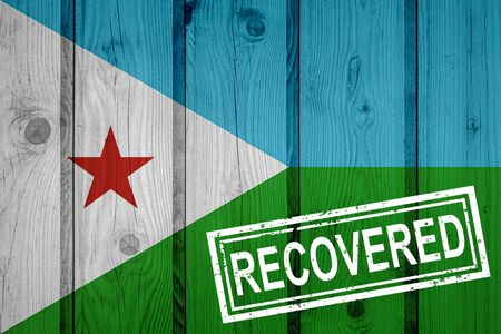 flag of Djibouti that survived or recovered from the infections of corona virus epidemic or coronavirus. Grunge flag with stamp Recovered